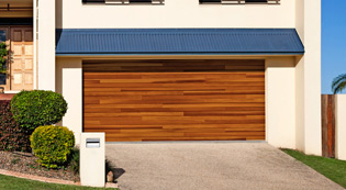 Crawford Door Lansing modern wooden residential garage doors.