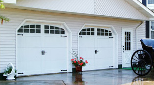 Crawford Door Lansing contemporary white residential garage doors with windows.