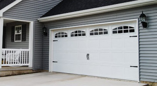 Crawford Door Lansing classic white residential garage doors.