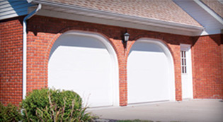 Crawford Door Lansing residential white garage doors.